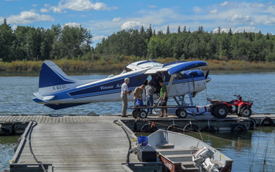 ACE Lab researchers load up a chartered boatplane, boat and quad for lake ecology research work (Photo: Scott Nielsen)