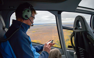 Scott marks points on interest on the GPS flying over the Ronald Lake bison study area (Photo: Mark Edwards)